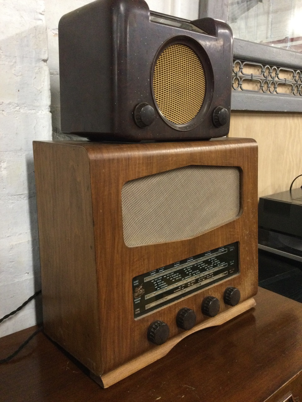 A bakelite cased Bush valve radio with circular speaker beneath glass dial; and a later walnut cased - Image 3 of 3