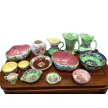A collection of Maling pottery including a tulip bowl, a pair of scalloped bowls, a graduated pair