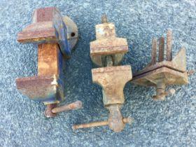 Three cast iron bench vices. (3)