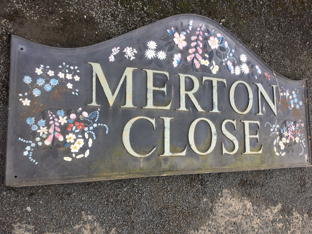 A rectangular sign handpainted & moulded in relief with flowers, in moulded frame. (56in x 26.5in) - Image 2 of 3