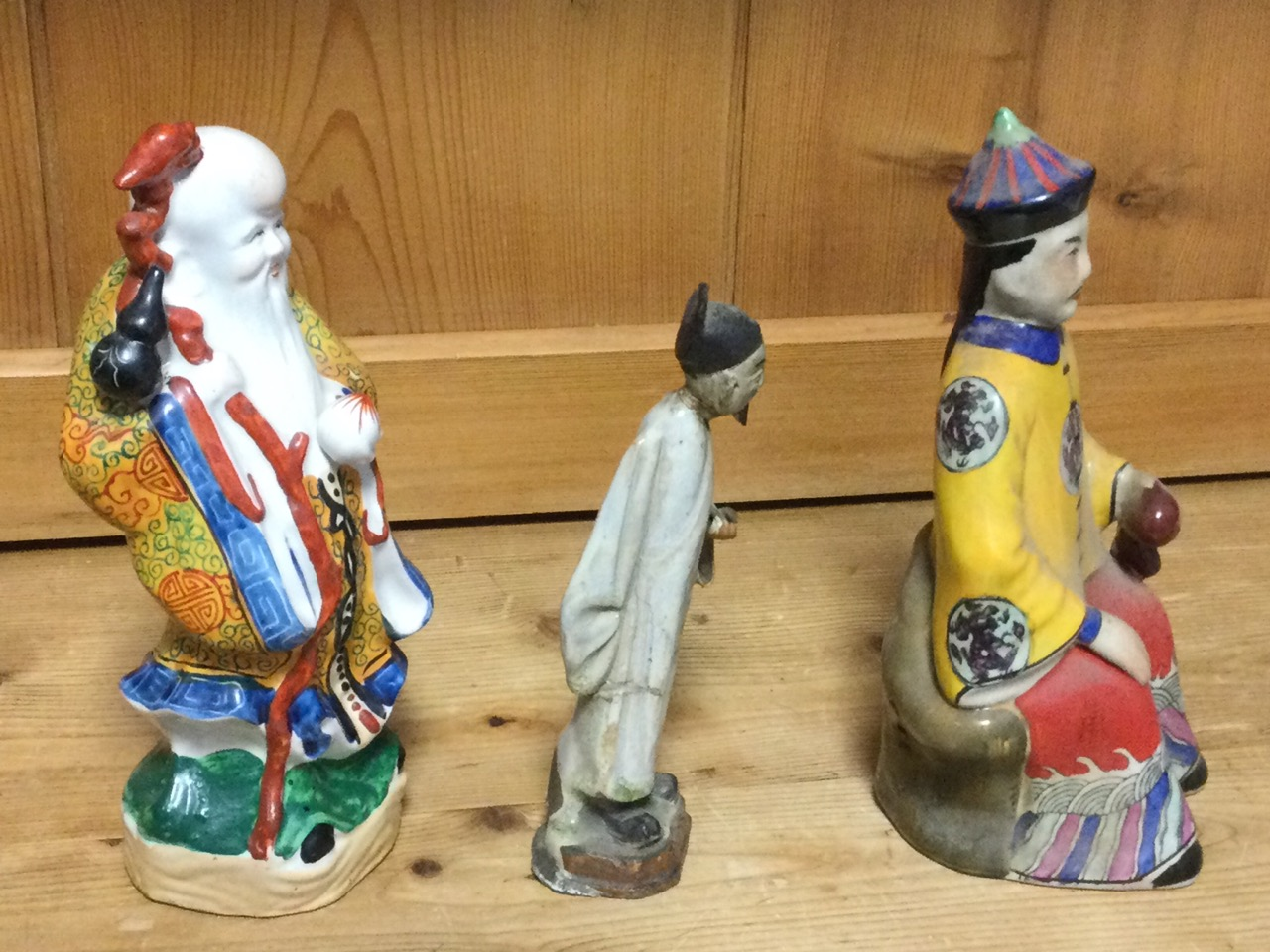 A seated Chinese stoneware figure; a porcelain figure of a bearded immortal in kimono; and a - Image 2 of 3
