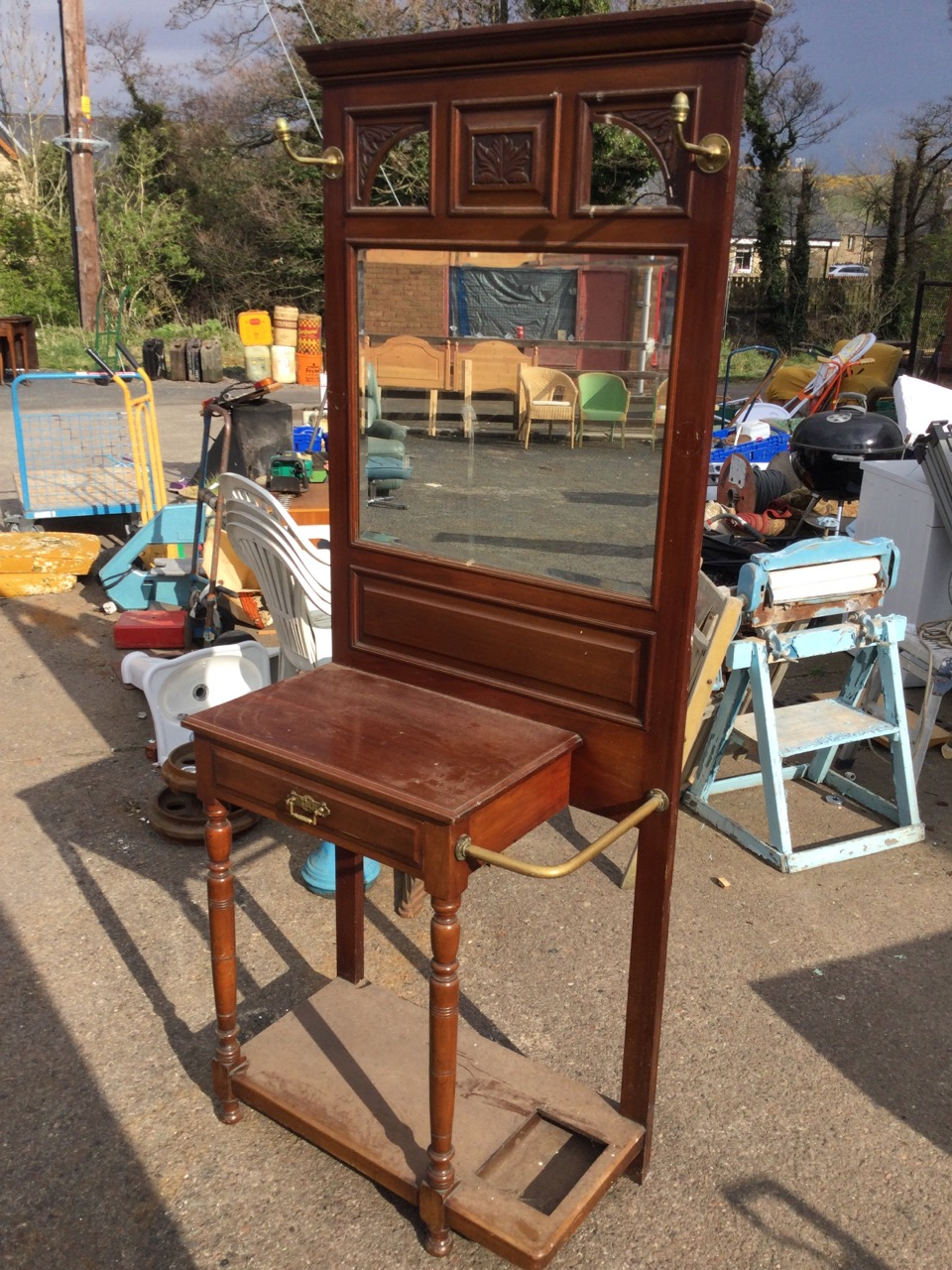 A late Victorian mahogany hallstand with moulded cornice above three leaf carved frames with - Image 3 of 3