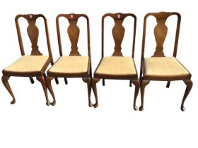 A set of four Queen Anne style walnut dining chairs with vase shaped splats above drop-in