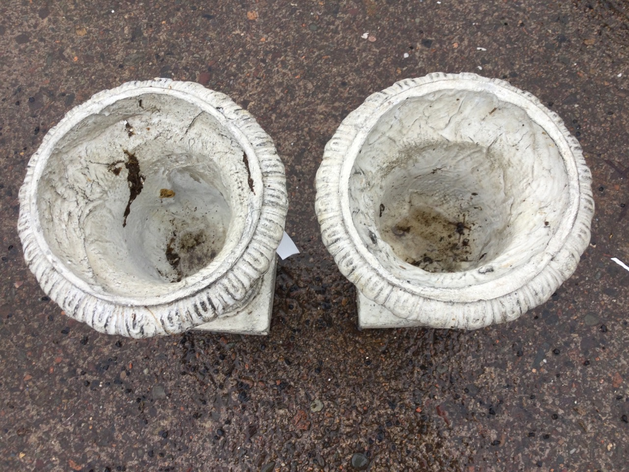 A pair of composition resin garden urns with lozenge moulded rims on fluted tapering bodies, with - Image 3 of 3