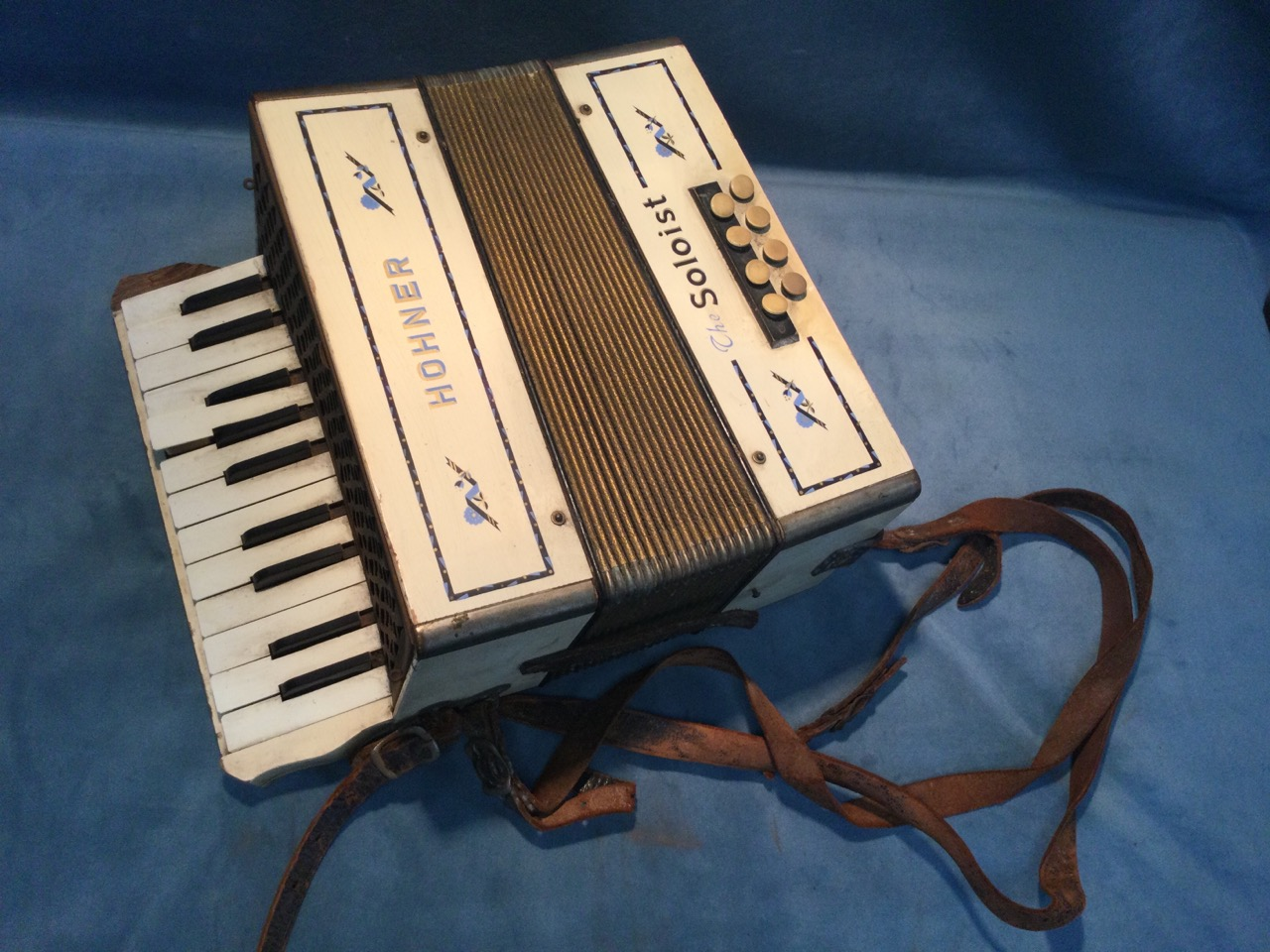 A early German Steel Reeds Hohner accordion, the painted case titled The Soloist, with two octave