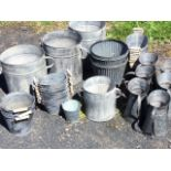 A florists backroom stock of galvanised tubs, buckets, jugs, fluted pots, oval tubs - some with wood