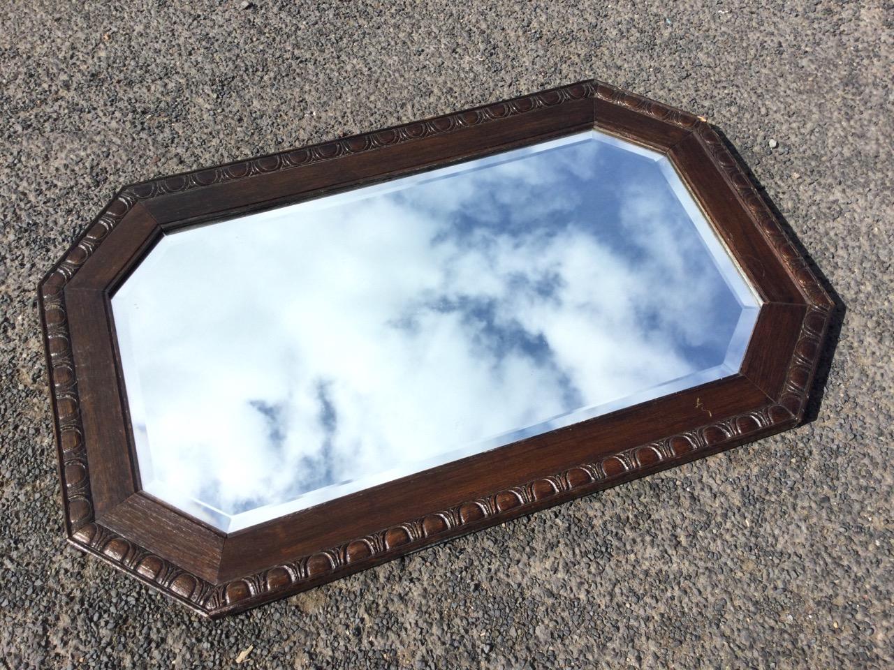 A George VI oak framed rectangular mirror, the bevelled plate in egg & dart carved octagonal - Image 2 of 3