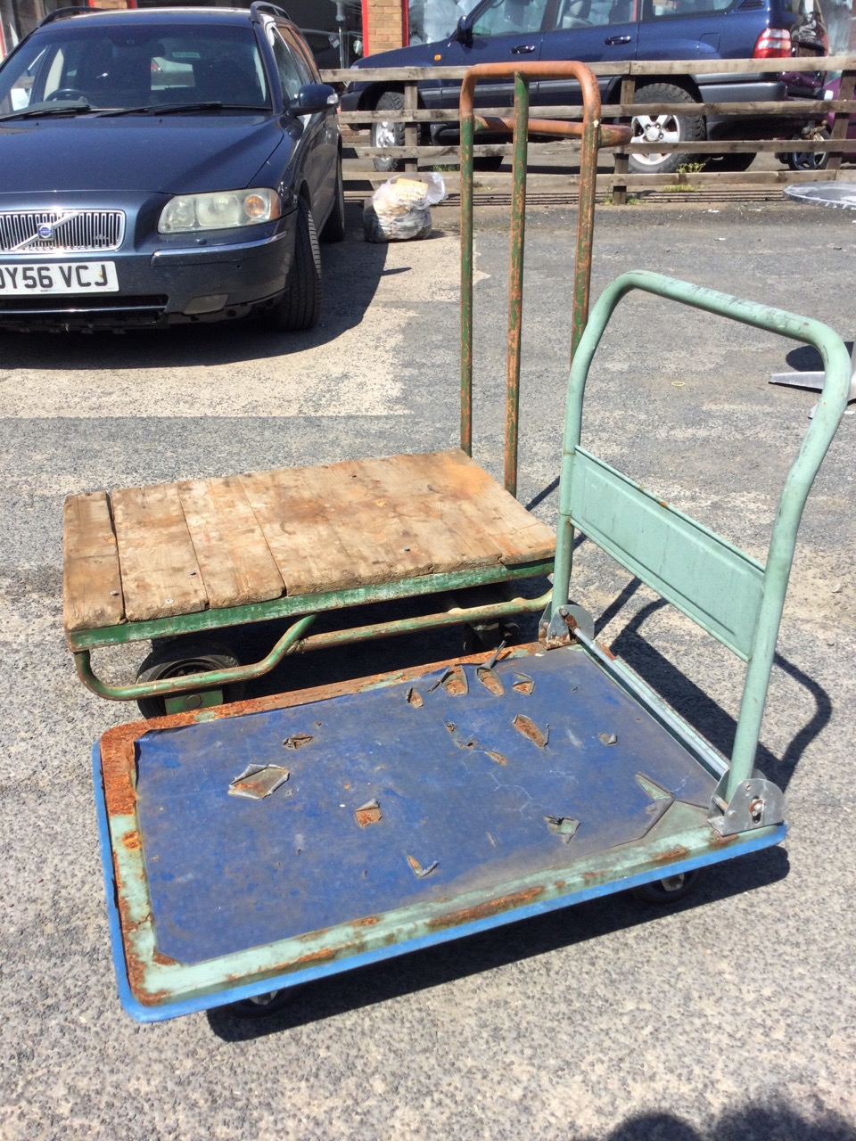 A four-wheel flatbed trolley with plank top on tubular steel frame, having pair of steering bogey - Image 2 of 3