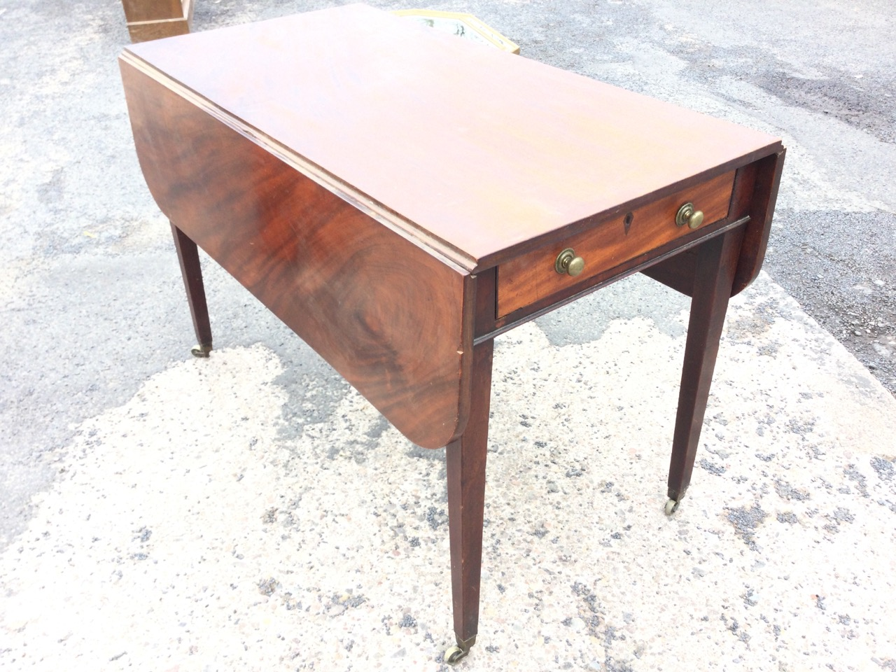 A rectangular nineteenth century mahogany pembroke table, the rectangular top with two rule-