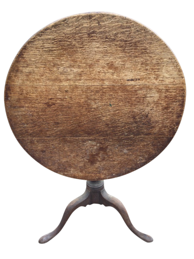 A circular nineteenth century oak snap-top table, raised on turned column with tripartite legs on