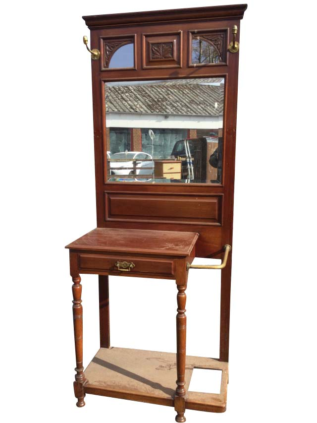 A late Victorian mahogany hallstand with moulded cornice above three leaf carved frames with