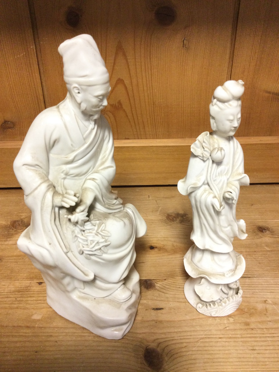 A C20th blanc-de-chin porcelain figure of a seated Chinese gentleman holding leaves; and another - Image 3 of 3