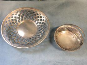 A hallmarked silver bon-bon dish with pierced sides and beaded rim having swing handle - Birmingham;