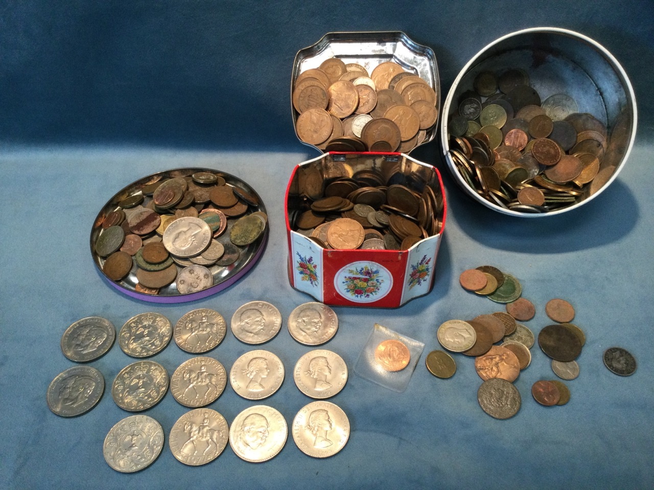Two tins of miscellaneous coins - pennies, coins, halfpennies, crowns, threepenny bits, sixpences,