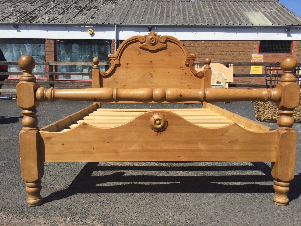 A pine double bed, with carved arched headboard framed by square cornerposts with ball finials, - Image 3 of 3