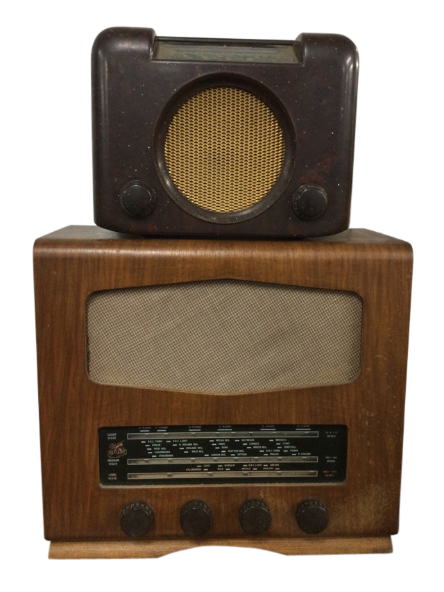 A bakelite cased Bush valve radio with circular speaker beneath glass dial; and a later walnut cased