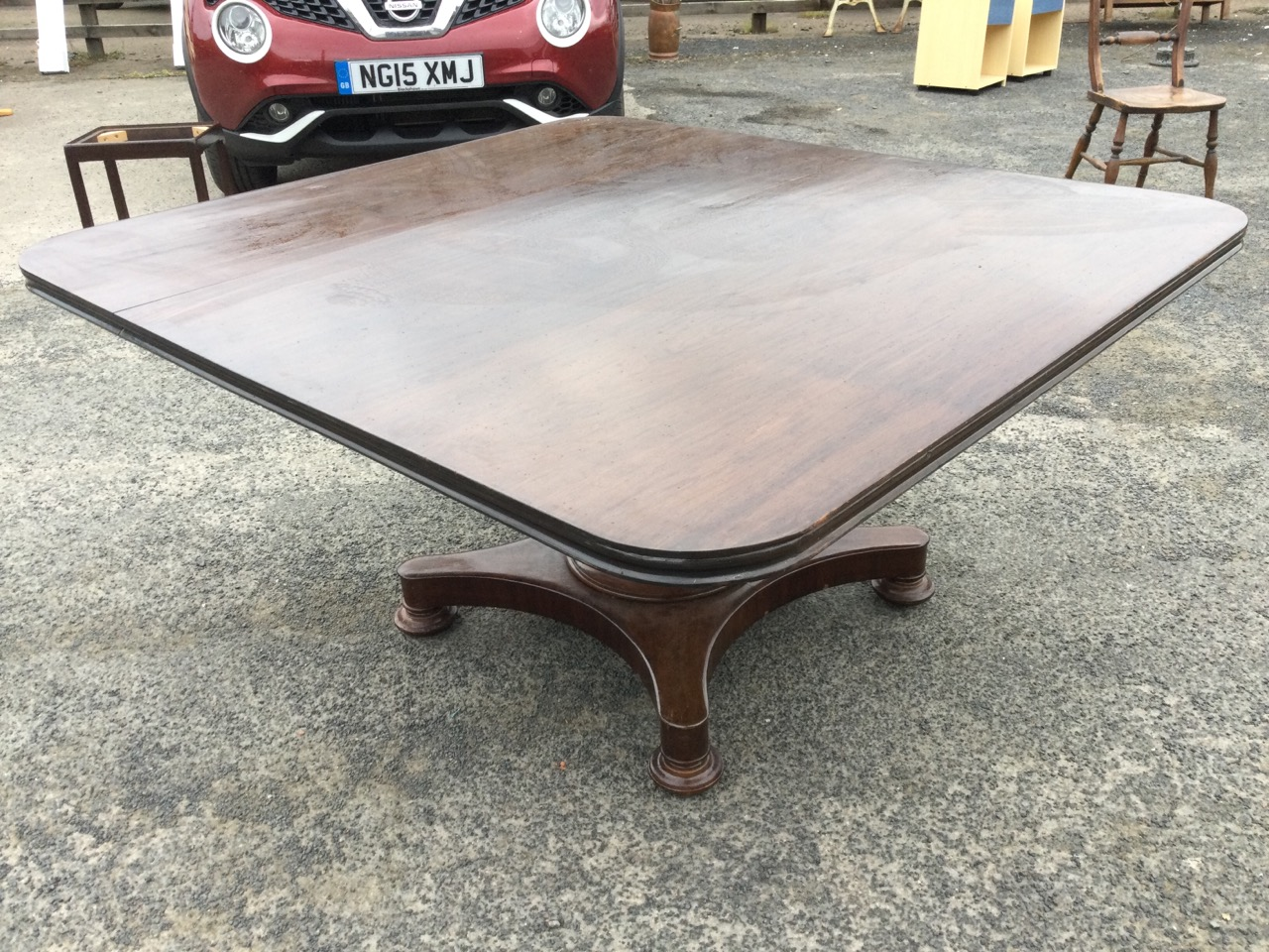 A large nineteenth century walnut breakfast table, the rectangular top with moulded edge raised on - Image 2 of 3