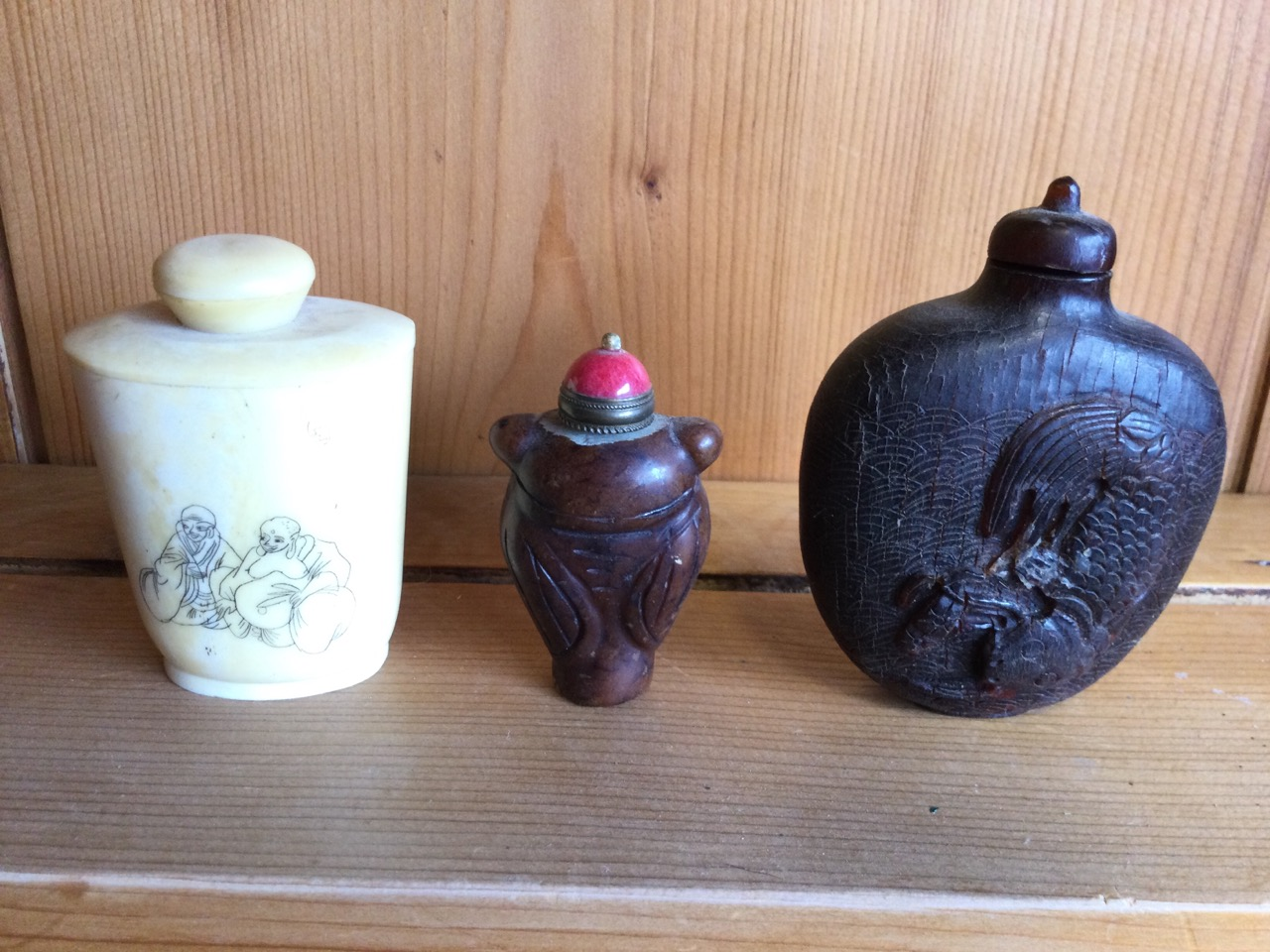 A tapering carved soapstone type snuff bottle with red ceramic stopper having brass mounts; - Image 2 of 3