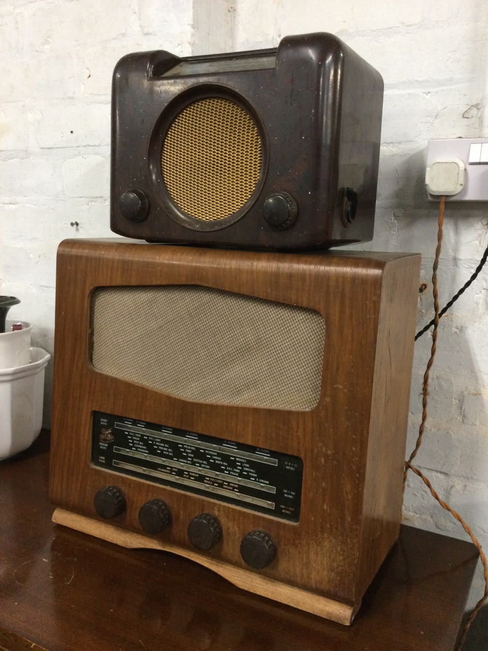 A bakelite cased Bush valve radio with circular speaker beneath glass dial; and a later walnut cased - Image 2 of 3