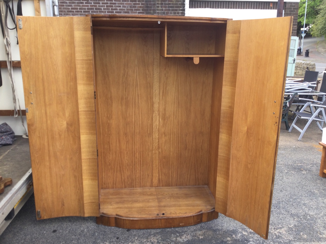 A deco walnut wardrobe of scalloped bowfronted outline having two doors enclosing an interior with - Image 3 of 3
