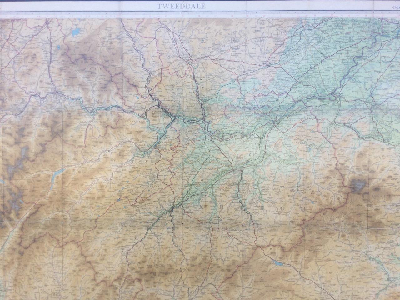 A rectangular framed C20th Bartholomews map of Tweeddale, the coloured half-inch plate centering
