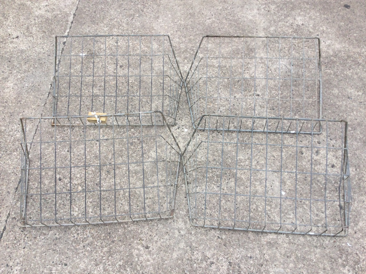 Four galvanised rectangular wall hanging hay hecks with angled sides. (38in x 16in x 20.5in) (4)
