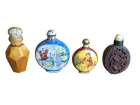 Two enamelled metal moonflask shaped snuff bottles with floral borders; a hexagonal amber type