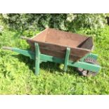 A large elm wheelbarrow with angled sides and tapering shafts, having pneumatic tyre. (60in)