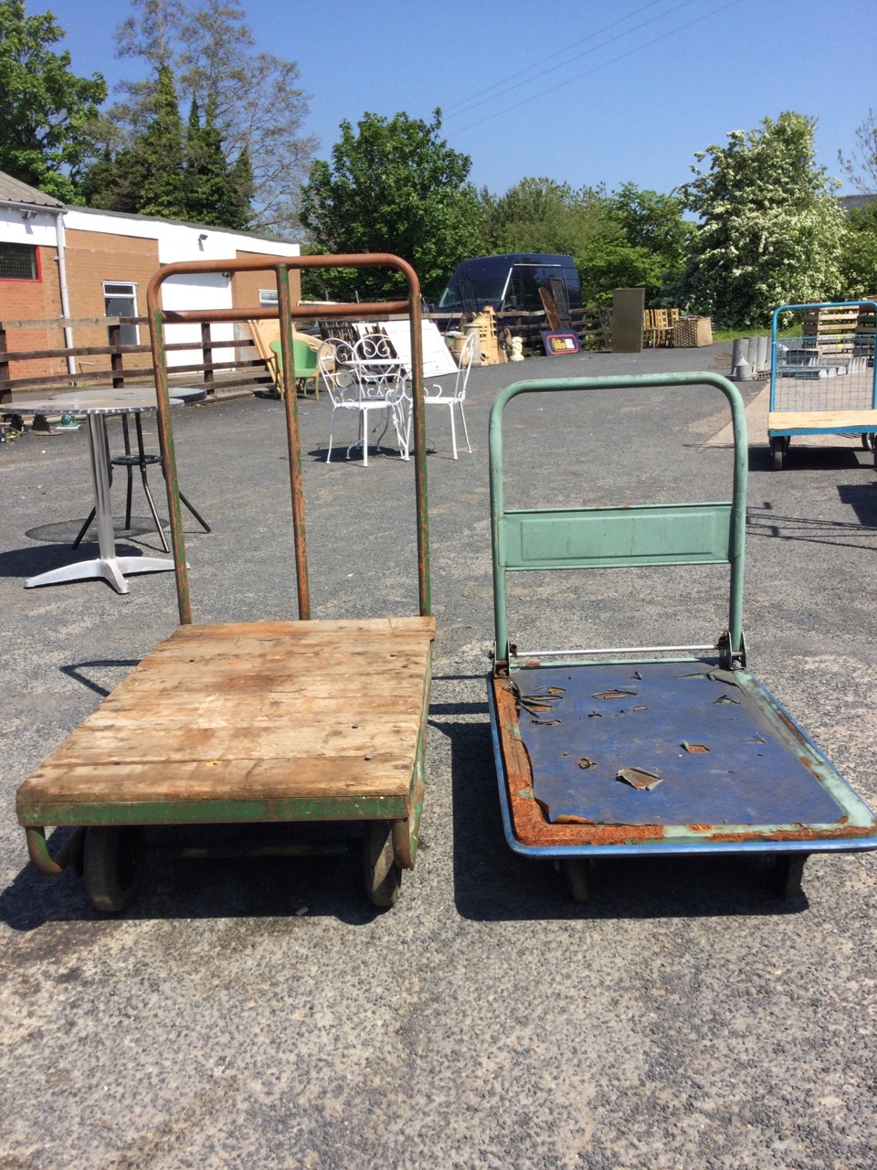 A four-wheel flatbed trolley with plank top on tubular steel frame, having pair of steering bogey - Image 3 of 3