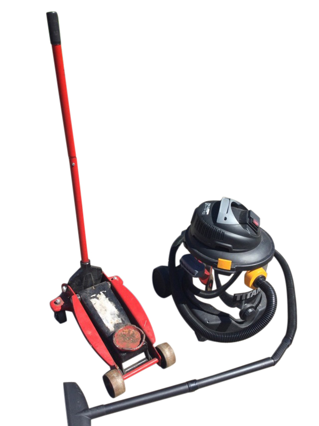 A car jack on wheels with crank handle; and a commercial Titan vacuum cleaner. (2)