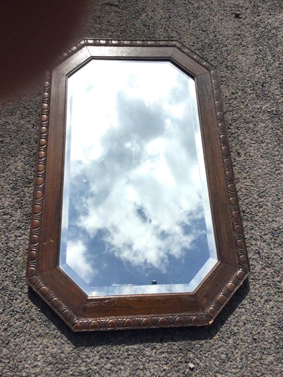 A George VI oak framed rectangular mirror, the bevelled plate in egg & dart carved octagonal - Image 3 of 3