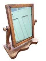 A Victorian mahogany dressing table mirror with rectangular cushion moulded plate on shaped