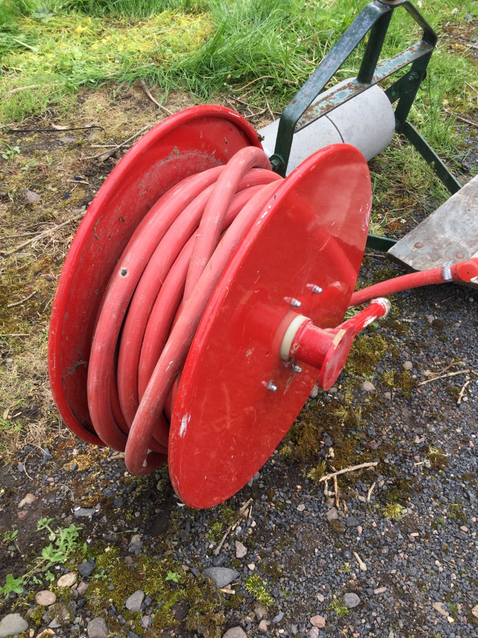 A firehose on reel complete with nozzle with tap; and a ride-on garden roller with tractor type seat - Image 2 of 3