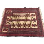 A Bokhara prayer rug woven with central serrated sword hung with pendants on fawn field, framed by