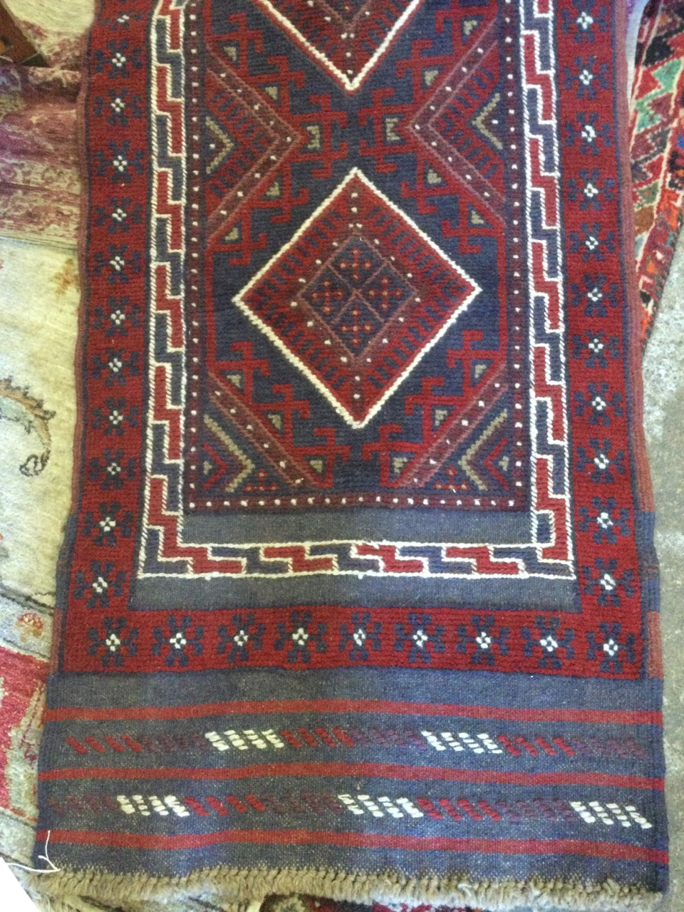 A Turkish runner woven with red field of four diamond shaped medallions with blue hooked borders, - Image 3 of 3