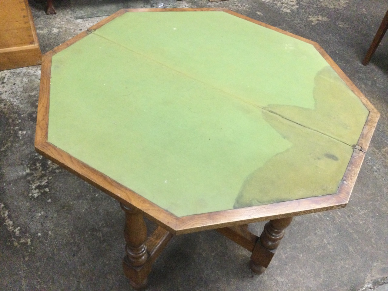An octagonal walnut turn-over-top games table having baize lined interior, raised on baluster turned - Image 2 of 3