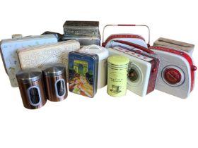 A collection of novelty tins - three modelled as radios, six similar of Paris, custard creams,