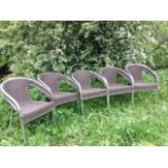 A set of five tubular chrome metal chairs with rounded frames, having faux cane backs & seats,