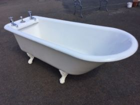 A Victorian 6ft cast iron roll-top bath, with rounded angled end opposite fitted original chrome
