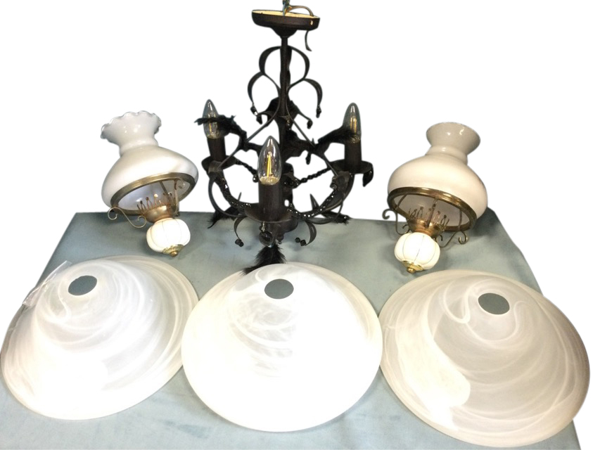 A contemporary wrought iron leaf hanging light with bead & feather swags, having three candlelights;