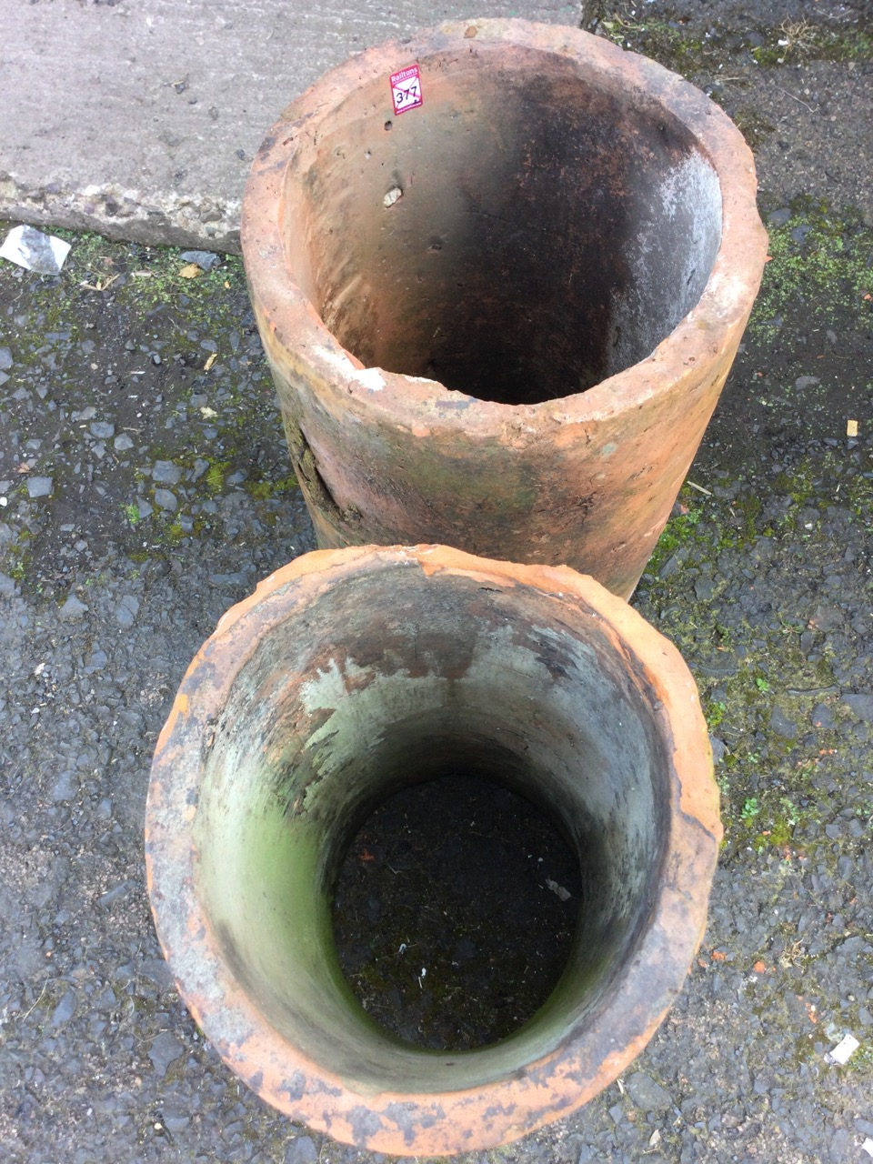 A pair of large tubular terracotta pipes - used as garden planters. (14in x 24in) (2) - Image 3 of 3
