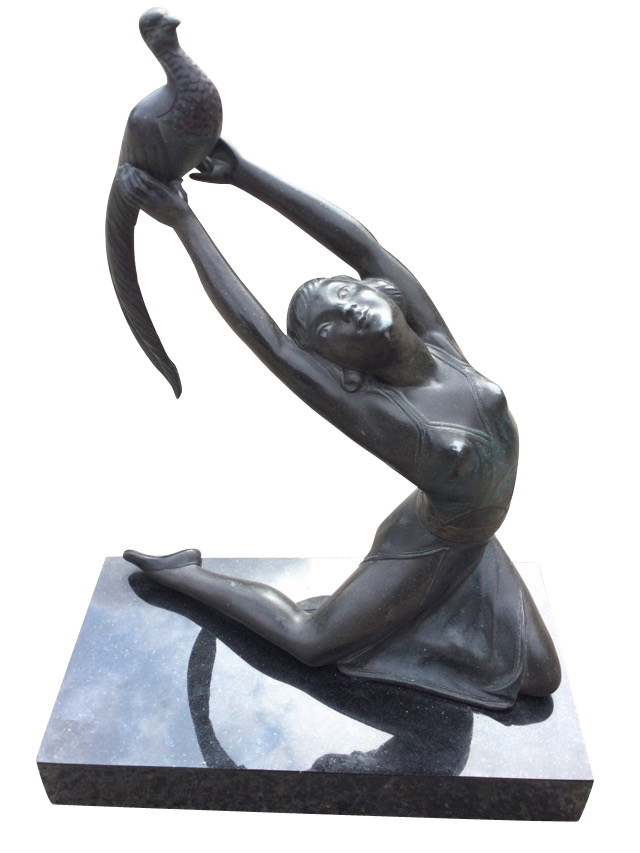 A French art deco style spelter figure of a dancing girl after Salvado, the bronze patinated lady