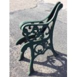 A pair of cast iron bench ends with scroll cast frames on channelled sabre legs - require re-