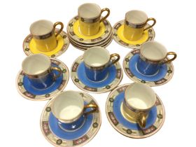 An Edwardian German Altwasser part coffee set with yellow & blue tubular cans having floral borders.