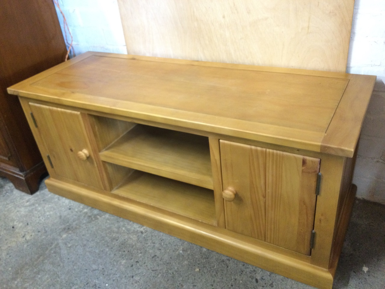 A contemporary oak side cabinet with rectangular top above central open shelves flanked by - Image 2 of 3