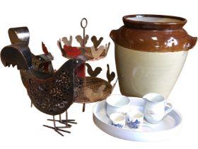 A large stoneware salt glazed bread crock, two ornamental fretwork metal hens, a cicukar egg stand