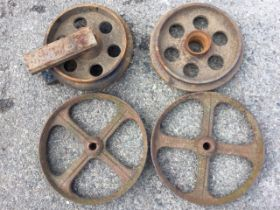 A pair of 15in cast iron wheels with flat rims, each with four spokes; and another pair of 13.5in