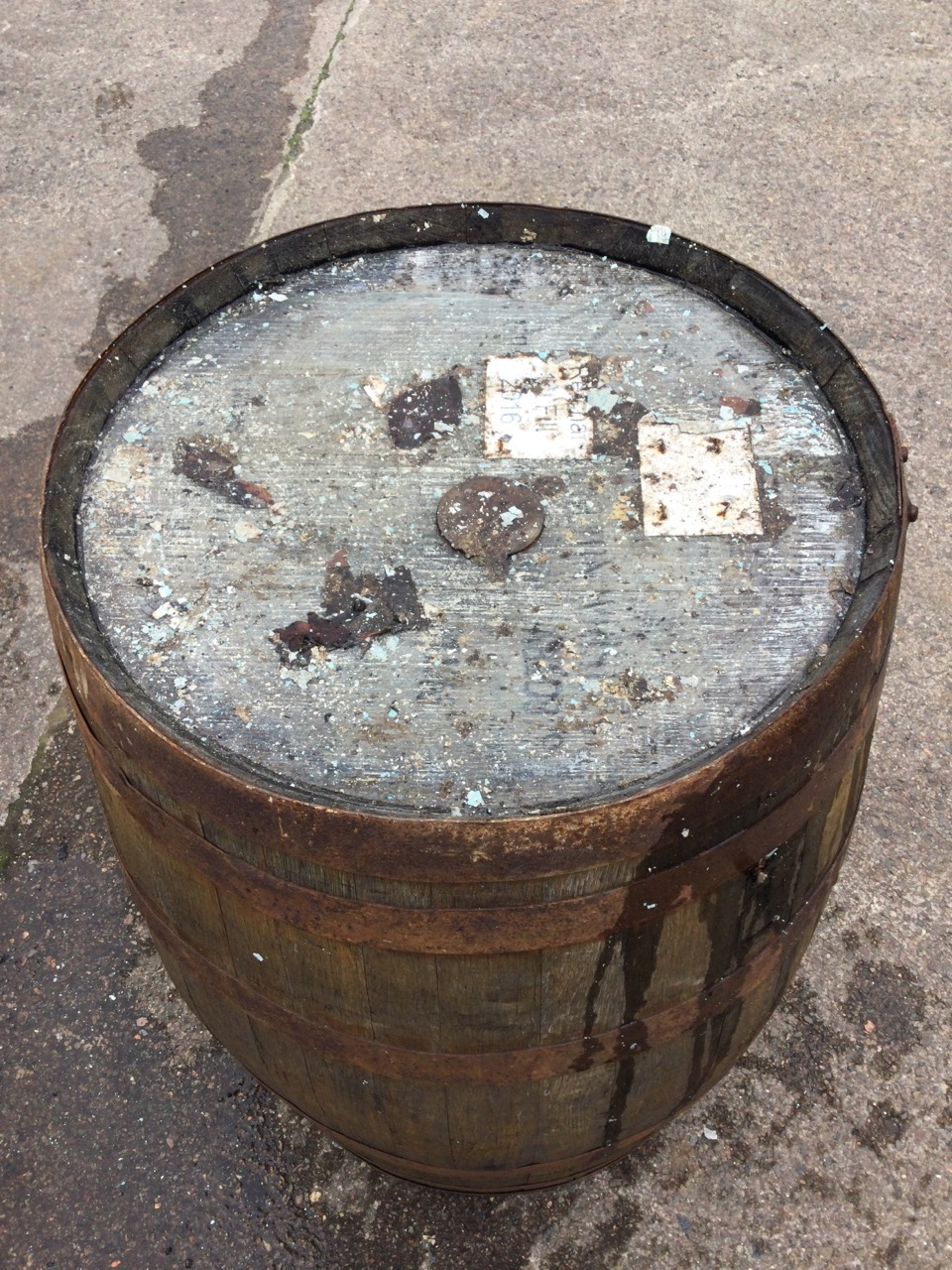 An oak whiskey barrel, the staves bound by six metal riveted strap bands. (34in) - Image 2 of 3
