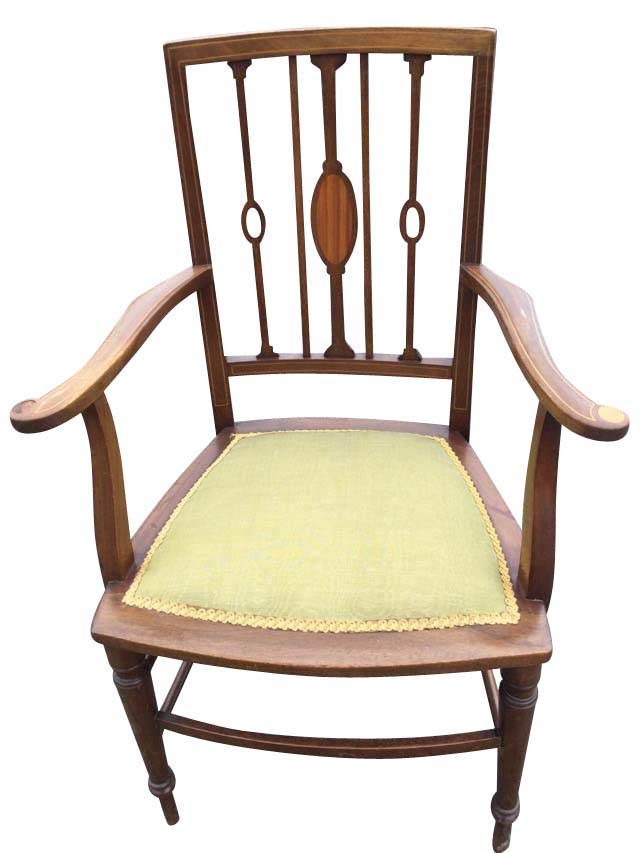 An Edwardian mahogany armchair inlaid with boxwood stringing, the back with slender spindles