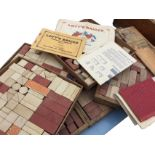 Several sets of Lotts composition stone bricks, the pieces in wood trays & boxes, with some original